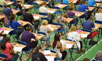 Students in an exam hall.